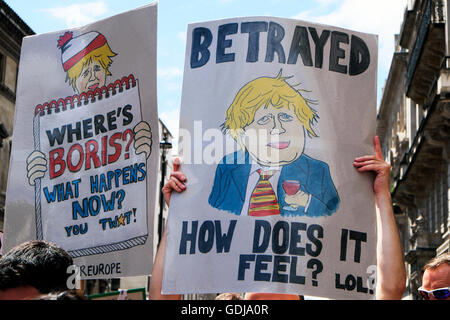Protesters protestors holding anti Boris Johnson posters at Brexit referendum  'March for Europe'  demonstration - Stock Photo