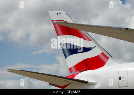 Logo of British Airways on the tail of an aircraft - Stock Photo