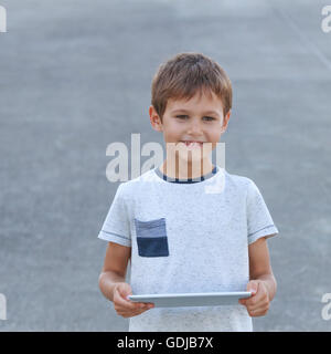 Smiling boy with tablet PC. Childhood, education, learning, technology, leisure concept - Stock Photo