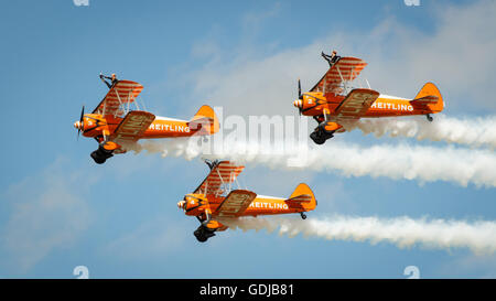 Breitling wing walkers on display in the UK on Boeing stearman A75N1s - Stock Photo
