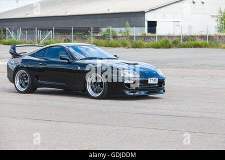 Kotka, Finland - July 16, 2016: Black Toyota Supra A80 goes down the street in town - Stock Photo