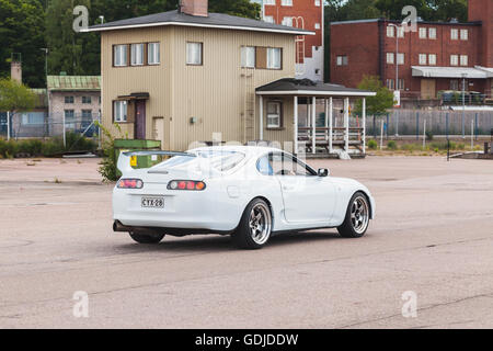 Kotka, Finland - July 16, 2016: White Toyota Supra A80 goes down the street in European town - Stock Photo