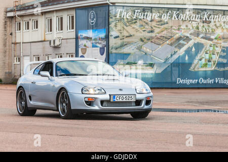 Kotka, Finland - July 16, 2016: Silver gray Toyota Supra A80 goes down the wide street - Stock Photo