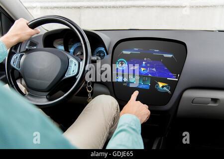 close up of man driving car with gps navigator map - Stock Photo