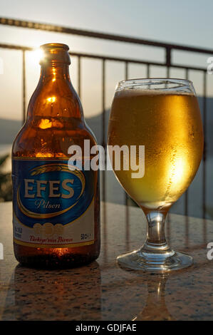 Bottle and glass of Efes Pilsen beer, Turkey. - Stock Photo