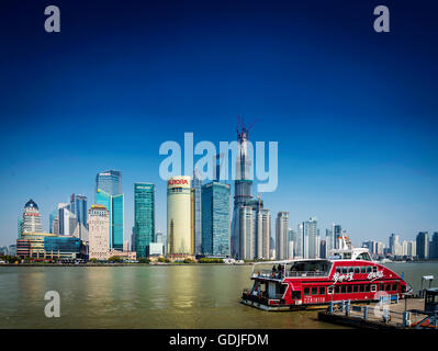 shanghai pudong city skyline and local river ferry boat in china - Stock Photo