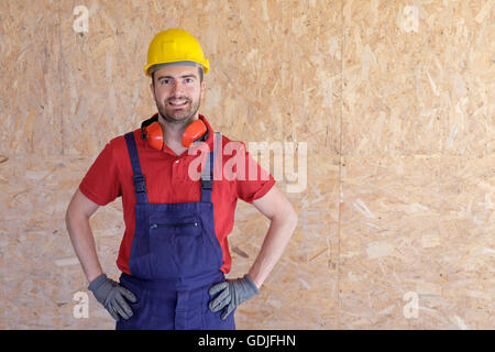 Portrait of a carpenter working in a construction site - Stock Photo