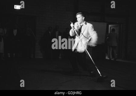 Elvis Presley during a performance at the University of Dayton Fieldhouse, May 27, 1956. - Stock Photo