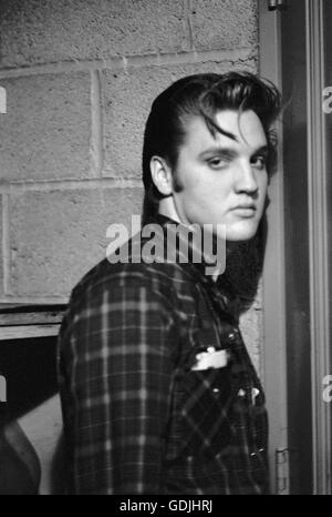 Elvis Presley, between performances, backstage at the University of Dayton Fieldhouse, May 27, 1956. - Stock Photo