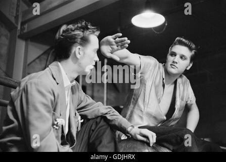 Elvis Presley and his cousin Gene Smith, backstage at the University of Dayton Fieldhouse, May 27, 1956. - Stock Photo