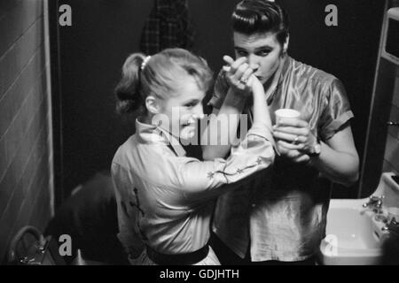 Elvis Presley meets a fan backstage at the University of Dayton Fieldhouse, May 27, 1956. - Stock Photo
