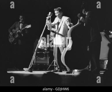 Elvis Presley in concert at the Fox Theater, Detroit, Michigan, May 25, 1956. - Stock Photo