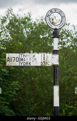 Helmsley, North Yorkshire - traditional cast iron sign post on the A170, pointing travelers in the right direction. - Stock Photo