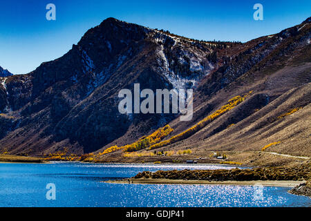 Fishermen at Grant lake California Highway 158 the June lake loop in the Eastern Sierra Nevada Mountains - Stock Photo