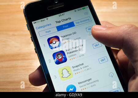 Bangkok, Thailand - July 17, 2016 : Pokemon Go is on the top of App Store Top Charts. - Stock Photo
