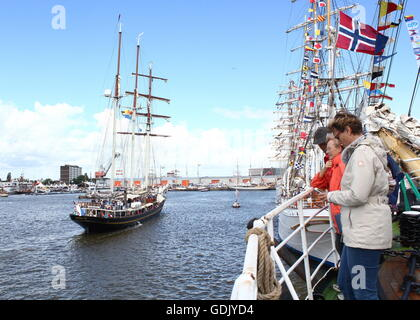 On deck of the Russian tall ship Kruzenshtern, watching another sailing ship (Gulden Leeuw) pass, at Delfsail Sailing - Stock Photo