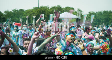 Chengdu, Sichuan province, China - July 2, 2016: Runners having fun at the Color Run China in Chengdu - Stock Photo