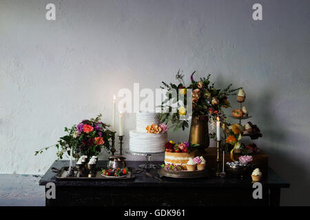 Sweet table inspired by Dutch masters still lifes. Dark shadows, window light, grain, shallow depth of field.
