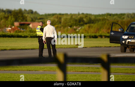 Police at the scene at Breighton airport near Selby, north Yorkshire, where five people have been seriously hurt - Stock Photo