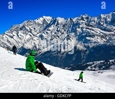 Snowboarder at Les Contamines-Montjoie ski resort, Haute-Savoie, France - Stock Photo