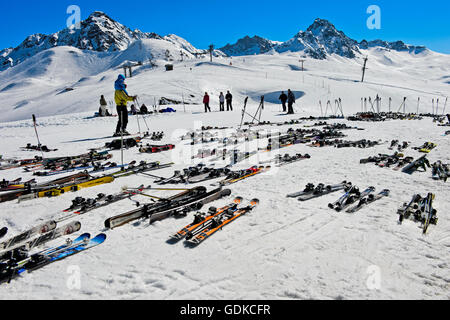Pairs of skis lying on snow, Col du Joly, Les Contamines-Montjoie ski resort, Haute-Savoie, France - Stock Photo