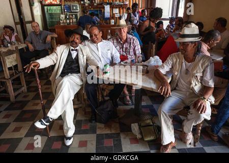 Men meeting in a Casa de la Trova, Santiago de Cuba Province, Santiago de Cuba Province, Cuba - Stock Photo