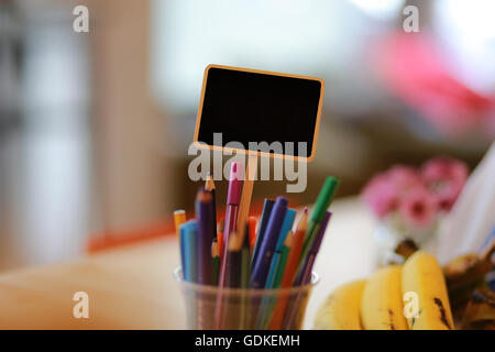 Black Label for writing text on the table. - Stock Photo