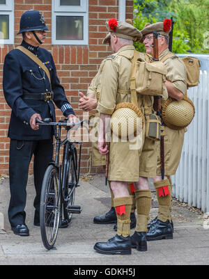 Woodhall Spa 1940s Festival - Soldiers talking to policeman - Stock Photo