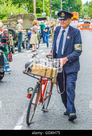 Woodhall Spa 1940s Festival - a 1940s postman with bicycle - Stock Photo