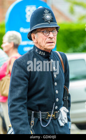 Woodhall Spa 1940s Festival - Policeman dressed in 1940s uniform with helmet - Stock Photo
