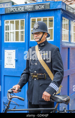 Woodhall Spa 1940s Festival - Policeman dressed in 1940s uniform stood by police box - Stock Photo