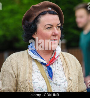Woodhall Spa 1940s Festival - Woman dressed in French Resistance style - Stock Photo