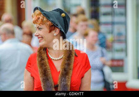 Woodhall Spa 1940s Festival - woman dressed in 1940s style with fox fur and hat - Stock Photo