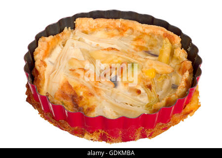 Handmade quiche in a small baking dish isolated on white background. - Stock Photo