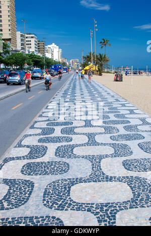 Sidewalk in Ipanema beach in Rio de Janeiro - Stock Photo