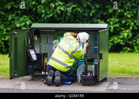 Openreach telephone and internet technician repairing a switch box, Scotland, UK - Stock Photo