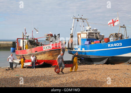 Hastings fishermen unloading fish on the Stade beach, East Sussex, England, UK - Stock Photo