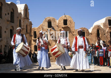 Tunisia Tataouine Governorate Ksar Ouled Soltane ancient fortress and local man singing, KSAR OULED SOLTANE, TUNISIA. - Stock Photo