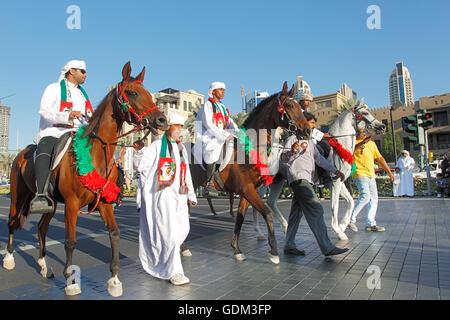 Celebrating National Day on Emaar Boulevard, Downtown, Dubai, UAE. - Stock Photo