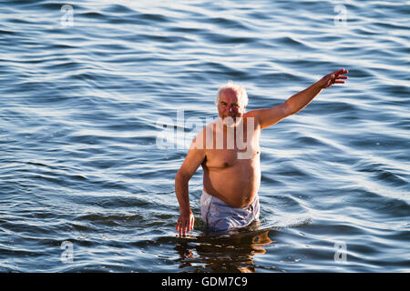 Aberystwyth Wales UK, Monday 18 July 2016  UK weather: A man enjoying himself in the sea in Aberystwyth on a very - Stock Photo