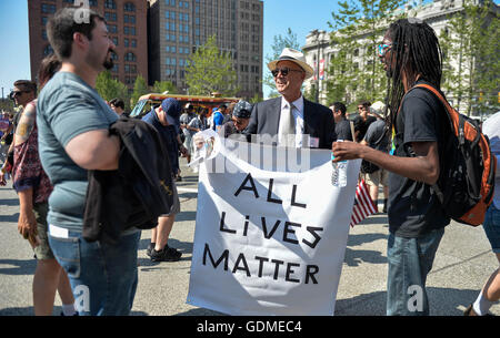 Cleveland, USA. 19th July, 2016. Protesters talk with each other during a rally outside the Republican National - Stock Photo