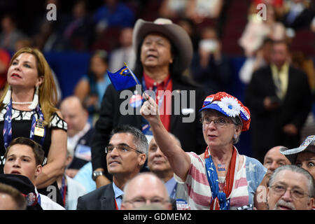 Cleveland, USA. 19th July, 2016. Delegates supporting Donald Trump cheer on the second day of the Republican National - Stock Photo