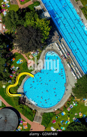 Witten, Germany 19th July, 2016 Aerial view, outdoor swimming pool Welper hattingen with waterslide and swimmer - Stock Photo