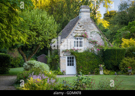 Early morning cottage in Castle Combe, Wiltshire, England - Stock Photo