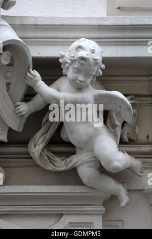 Angel, detail from the house of the Knights of the Cross with the Red Star on October 10, 2014 in Vienna - Stock Photo