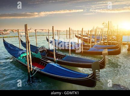 Venice with gondolas on Grand Canal against San Giorgio Maggiore church in Venice, Italy - Stock Photo