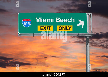 Miami Beach exit only highway sign with sunrise sky. - Stock Photo