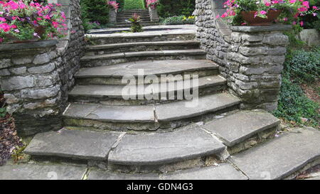 old stone steps leading up to a quiet area to rest and relax - Stock Photo