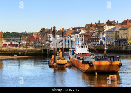 A large yellow trawler boat within the harbour. In Whitby, North Yorkshire, England. On 16th July 201 - Stock Photo
