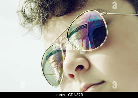 Teenage boy with mirroring bridge in sunglasses. Summer theme. Youngster portrait. - Stock Photo